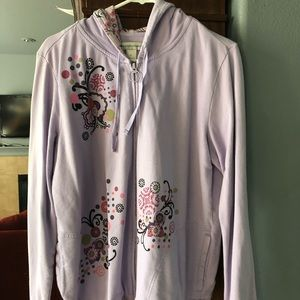 Zipp up sweatshirt with cute designs.